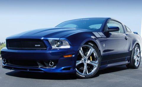 Motor vehicle, Tire, Automotive design, Blue, Daytime, Automotive tire, Hood, Headlamp, Automotive lighting, Rim,