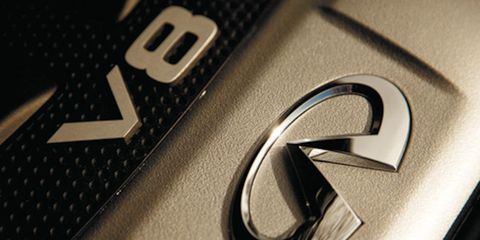 Text, Logo, Font, Symbol, Metal, Carbon, Material property, Close-up, Brand, Trademark,