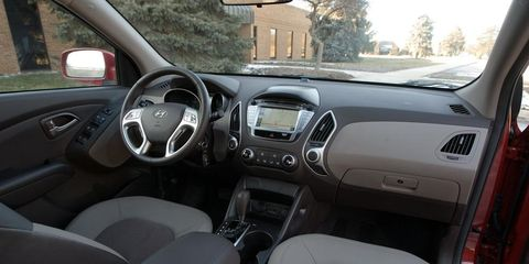 Motor vehicle, Steering part, Mode of transport, Brown, Vehicle, Steering wheel, Automotive mirror, Center console, Glass, White,
