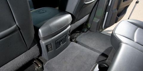 Motor vehicle, Mode of transport, Car seat, Car seat cover, Vehicle door, Fixture, Head restraint, Luxury vehicle, Automotive window part, Seat belt,