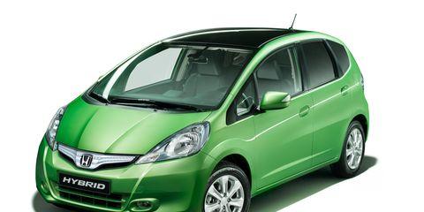 Motor vehicle, Automotive mirror, Tire, Wheel, Mode of transport, Automotive design, Glass, Transport, Vehicle, Vehicle door,