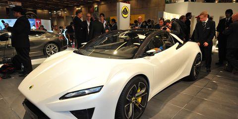 Wheel, Tire, Automotive design, Vehicle, Land vehicle, Event, Car, Auto show, Exhibition, Supercar,