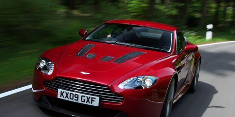 Tire, Wheel, Automotive design, Vehicle, Car, Rim, Red, Fender, Automotive tire, Performance car,