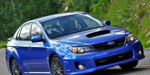 Tire, Blue, Daytime, Vehicle, Automotive design, Automotive lighting, Rim, Hood, Headlamp, Car,