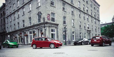 Wheel, Tire, Mode of transport, Window, Vehicle, Land vehicle, Automotive parking light, Automotive design, Car, Neighbourhood,