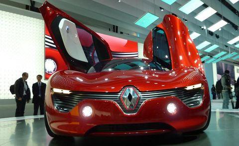 Motor vehicle, Mode of transport, Automotive design, Vehicle, Event, Concept car, Grille, Automotive mirror, Red, Car,