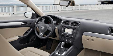 Motor vehicle, Steering part, Mode of transport, Steering wheel, Automotive mirror, Brown, Automotive design, Vehicle, Transport, Center console,