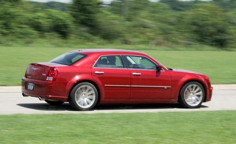 Tire, Wheel, Vehicle, Automotive design, Rim, Transport, Automotive tire, Red, Car, Alloy wheel,