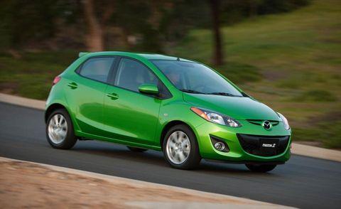 Motor vehicle, Wheel, Tire, Mode of transport, Automotive design, Green, Daytime, Automotive mirror, Vehicle, Car,