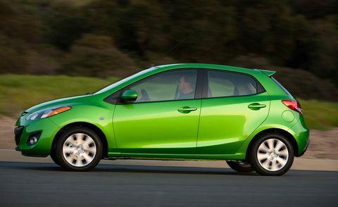 Tire, Wheel, Motor vehicle, Mode of transport, Automotive design, Automotive mirror, Green, Vehicle, Yellow, Car,