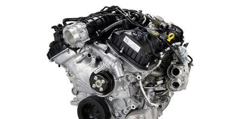 Engine, Machine, Automotive engine part, Metal, Motorcycle accessories, Silver, Automotive super charger part, Automotive engine timing part, Still life photography, Transmission part,