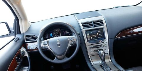 Motor vehicle, Automotive design, Product, Steering wheel, Steering part, White, Car, Center console, Technology, Vehicle audio,