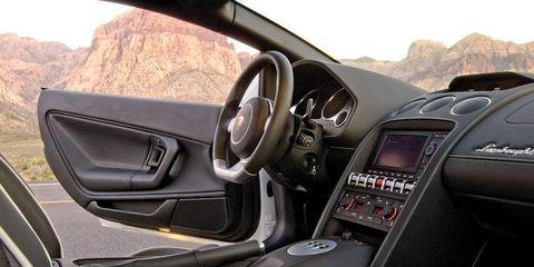Motor vehicle, Mode of transport, Steering part, Automotive mirror, Steering wheel, Automotive design, Center console, Car, Glass, Luxury vehicle,
