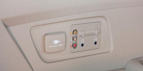White, Fixture, Beige, Composite material, Gas, Machine, Plastic, Automotive door part, Electrical supply,