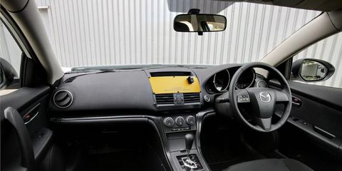 Motor vehicle, Automotive mirror, Mode of transport, Automotive design, Steering part, Steering wheel, Personal luxury car, Center console, Vehicle door, Rear-view mirror,