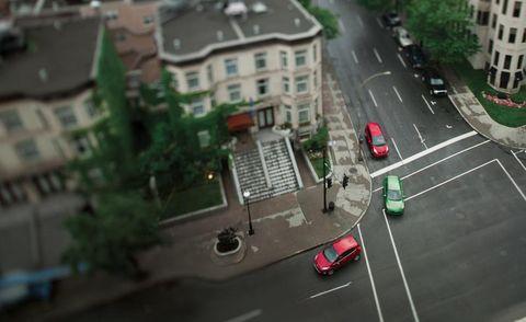 Motor vehicle, Road, Mode of transport, Automotive design, Street, Residential area, Window, Town, Neighbourhood, Urban area,