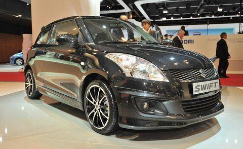 Motor vehicle, Tire, Automotive design, Mode of transport, Vehicle, Land vehicle, Event, Car, Grille, Headlamp,