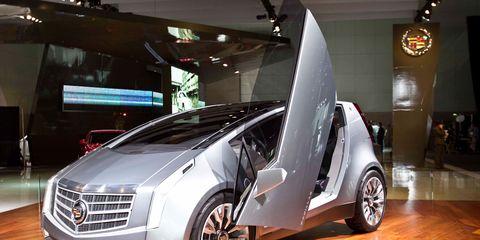 Automotive design, Vehicle, Land vehicle, Concept car, Floor, Car, Auto show, Fender, Grille, Personal luxury car,
