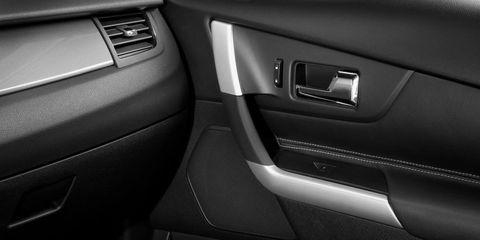Vehicle door, Automotive exterior, Fixture, Grey, Luxury vehicle, Personal luxury car, Automotive door part, Silver, Machine,