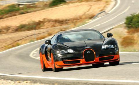 Automotive mirror, Road, Automotive design, Vehicle, Infrastructure, Road surface, Hood, Car, Asphalt, Performance car,