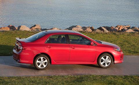 Tire, Wheel, Automotive design, Vehicle, Car, Alloy wheel, Rim, Red, Full-size car, Automotive tail & brake light,