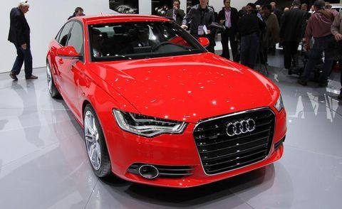 Automotive design, Vehicle, Event, Grille, Car, Audi, Personal luxury car, Alloy wheel, Luxury vehicle, Auto show,