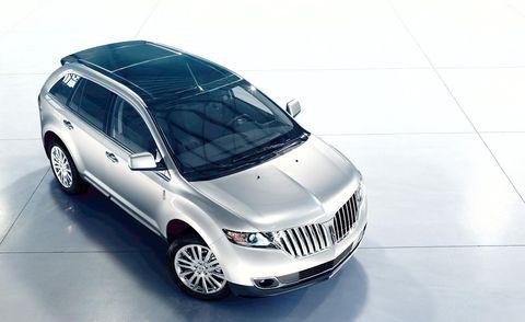 Tire, Motor vehicle, Automotive tire, Automotive design, Product, Automotive mirror, Vehicle, Glass, Automotive lighting, Automotive exterior,