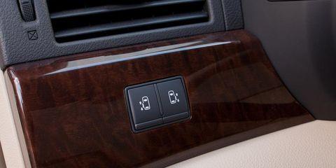 Motor vehicle, Brown, Automotive exterior, Vehicle door, Logo, Maroon, Tan, Trunk, Wood stain, Automotive door part,