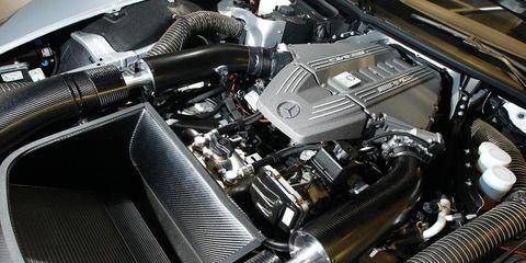 Motor vehicle, Automotive design, Engine, Automotive engine part, Personal luxury car, Automotive air manifold, Luxury vehicle, Classic, Automotive super charger part, Automotive fuel system,
