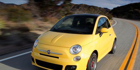 Motor vehicle, Tire, Wheel, Automotive design, Vehicle, Yellow, Rim, Automotive wheel system, Car, Road,