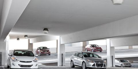 Land vehicle, Automotive design, Vehicle, Car, Automotive parking light, Grille, Automotive lighting, Ceiling, Alloy wheel, Rim,