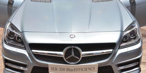 Mode of transport, Automotive design, Vehicle, Grille, Automotive exterior, Land vehicle, Car, Personal luxury car, Mercedes-benz, White,