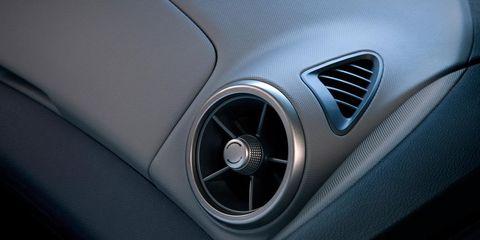 Automotive design, Personal luxury car, Luxury vehicle, Carbon, Grey, Symbol, Silver, Steering wheel, Trademark, Executive car,