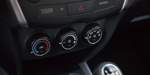 Motor vehicle, Red, Logo, Black, Luxury vehicle, Machine, Gauge, Gear shift, Symbol, Personal luxury car,