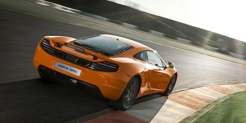 Tire, Mode of transport, Automotive design, Vehicle, Land vehicle, Infrastructure, Car, Road, Vehicle registration plate, Performance car,