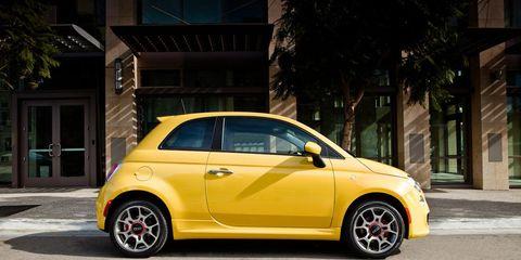 Tire, Wheel, Motor vehicle, Automotive design, Yellow, Vehicle, Automotive tire, Rim, Automotive wheel system, Car,