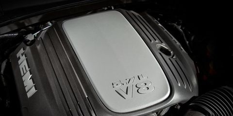 Motor vehicle, Automotive design, Fender, Automotive lighting, Motorcycle accessories, Automotive fuel system, Luxury vehicle, Still life photography, Kit car, Carbon,