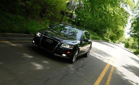 Automotive design, Road, Vehicle, Land vehicle, Grille, Car, Road surface, Automotive lighting, Asphalt, Audi,