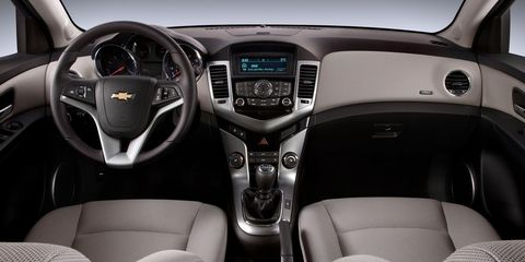 Motor vehicle, Automotive design, Product, Brown, Steering part, Steering wheel, Transport, Center console, White, Technology,