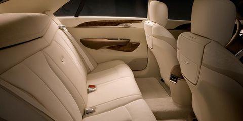 Motor vehicle, Car seat, Head restraint, Car seat cover, Beige, Vehicle door, Luxury vehicle, Seat belt, Family car, Leather,