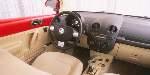 Motor vehicle, Steering part, Mode of transport, Brown, Steering wheel, Vehicle door, Car seat, Center console, Car seat cover, Gear shift,
