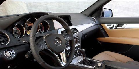 Motor vehicle, Steering part, Mode of transport, Steering wheel, White, Vehicle door, Speedometer, Gauge, Center console, Automotive mirror,
