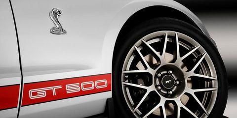 Motor vehicle, Automotive design, Automotive exterior, Alloy wheel, Automotive tire, Rim, Automotive wheel system, White, Spoke, Fender,