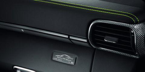 Automotive design, Automotive exterior, Grille, Logo, Personal luxury car, Luxury vehicle, Bumper part, Bumper, Hood, Carbon,