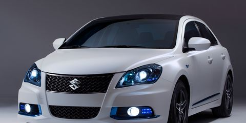Motor vehicle, Blue, Automotive design, Mode of transport, Daytime, Vehicle, Transport, Hood, Headlamp, Automotive mirror,