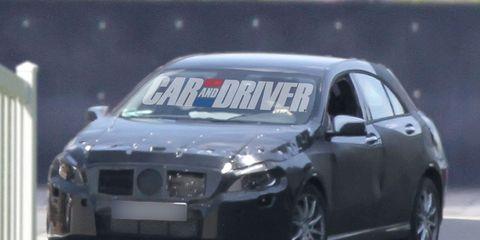Motor vehicle, Mode of transport, Daytime, Vehicle, Automotive mirror, Car, Hood, Alloy wheel, Headlamp, Automotive exterior,