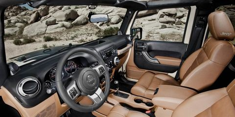 Motor vehicle, Steering part, Mode of transport, Steering wheel, Brown, Vehicle, Automotive design, Vehicle door, Car seat, Car,