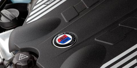Motor vehicle, Automotive design, Logo, Electric blue, Symbol, Machine, Emblem, Carbon, Bmw,