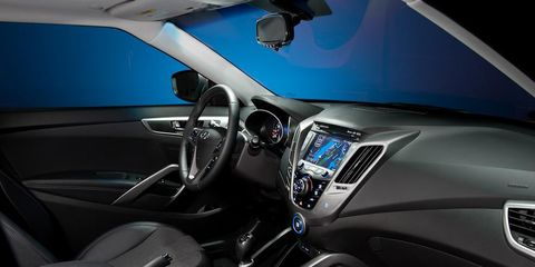 Motor vehicle, Mode of transport, Blue, Automotive design, Steering part, Transport, Automotive mirror, Steering wheel, Car, Glass,
