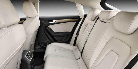 Motor vehicle, Car seat, White, Head restraint, Vehicle door, Car seat cover, Fixture, Seat belt, Luxury vehicle, Leather,